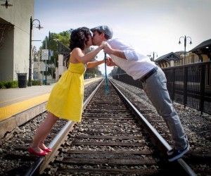 Kristina and Shelby kissing on train tracks